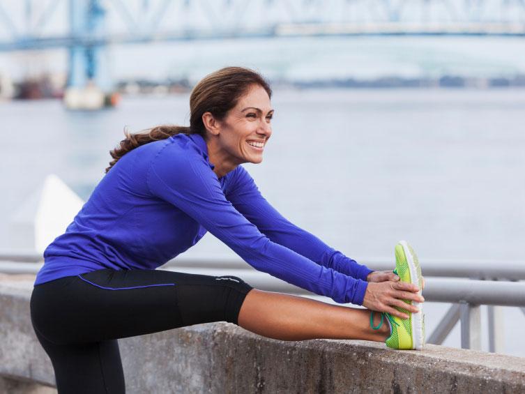 woman-runner-stretching